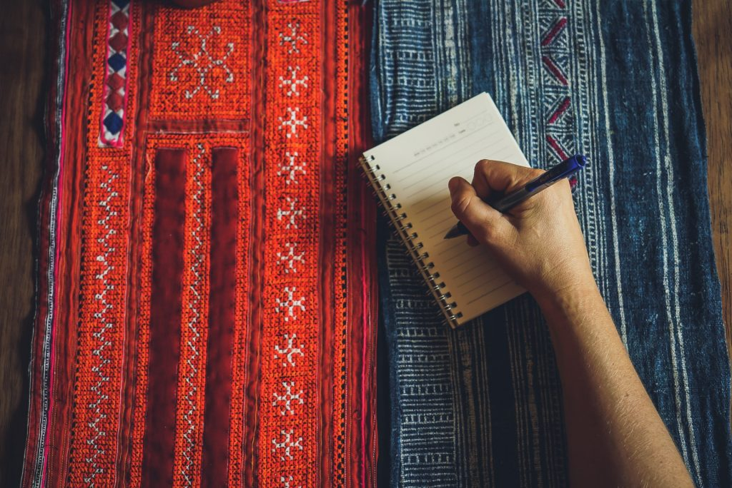 successful creative business owner journaling
